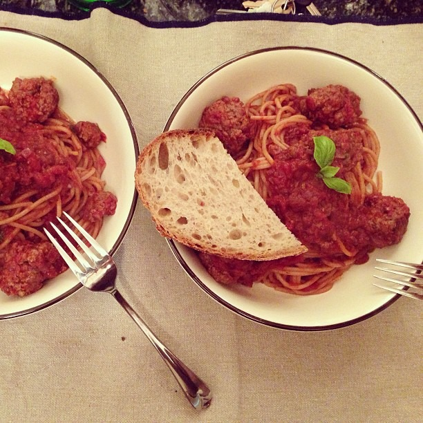Spaghetti and meatball night! Sauce: San marzano tomatoes, sweated onions and garlic, extra-virgin olive oil, basil leaves, pepper flakes Meatballs: Beef, veal, pork, bellwether ricotta, parmesan, bread crumbs, milk, egg, pepper flakes