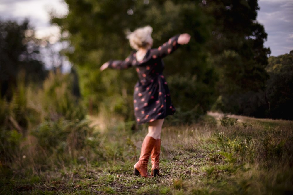 Me doing my best aeroplane impersonation.  No, honestly it's me just playing around in my Grandparents paddock. The wildness of 'home'.   Photo credit:  Cathy Ronalds