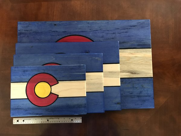Elevation Creations - Elevation Creations creates masterful woodworked pieces of all kinds. There are cutting boards, wall hangings and cheese boards with an attached cutter all with a Colorado theme. Of course, we have
