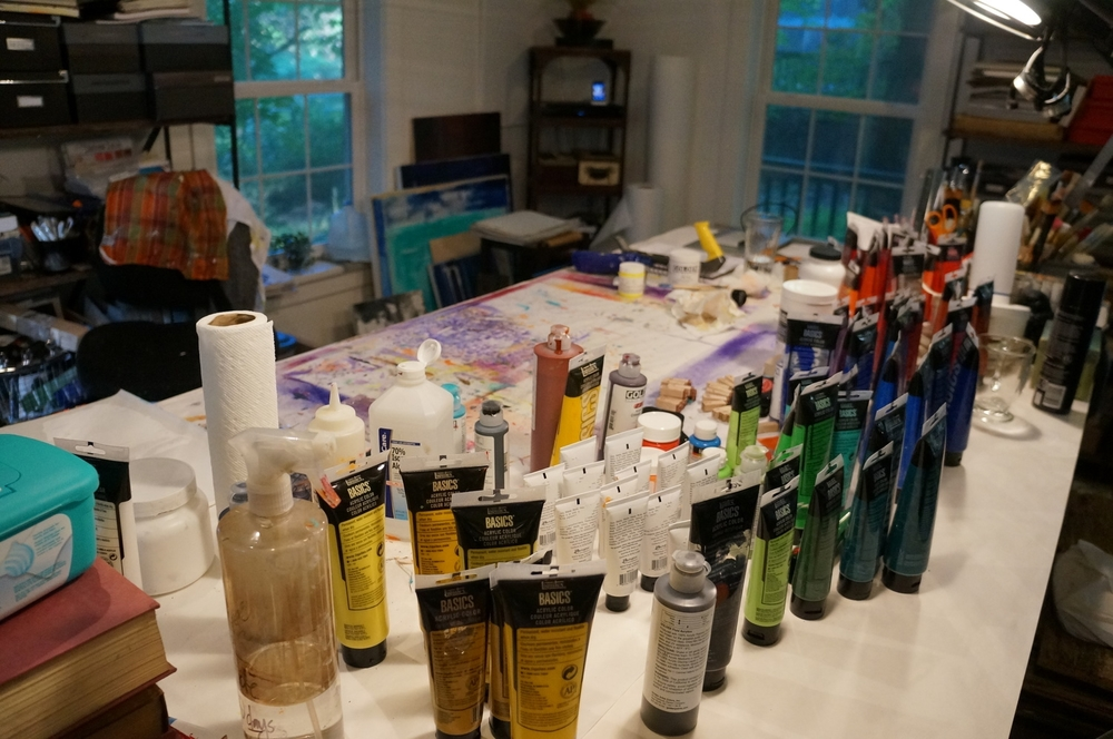 The work table with the rapidly advancing tubes of paint, bottles of solvent, ink, gesso, fiber paste, and matte medium.  The tools getting ready to revolt!