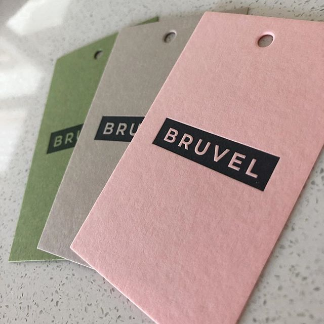 We can't get enough of this colour palette! Swing tags we designed and printed for @bruvelis on 300gsm Gmund Rosa, Stone and Pear.