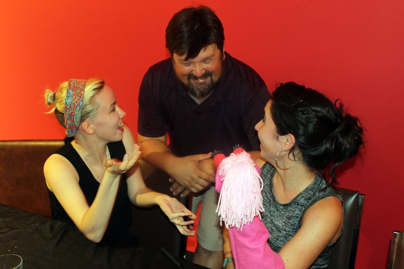 Montana chatting with Puppet Director Scott Hitz and Puppet Builder Katie McGeorge.