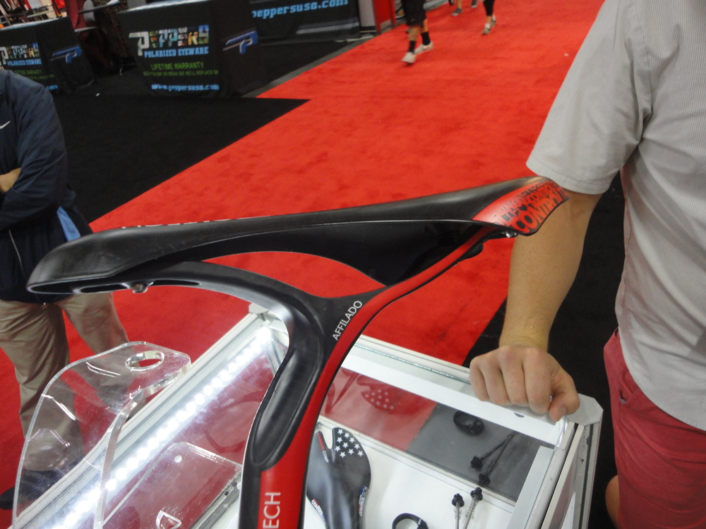 Ultra-lite seatpost and saddle system. The saddle has a small amount of for-aft adjustability.