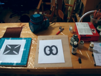 Assembling the graphics to cut stencils for painting.