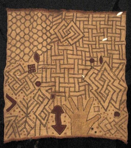 "Panel (ncák) 20th century; raffia, embroidery, 23-1/4"" x 24-3/4 (59 x 63 cm). Musée Royal de L'Afrique Central, Tervuren. It is very rare to see a hand portrayed in a cloth. Perhaps it is a reminder of the atrocious actions of the the Leopold regime?"