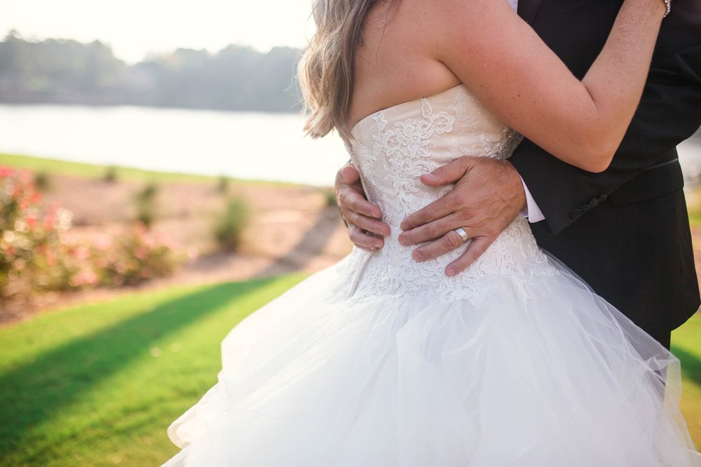 Bride and Groom hugging = Dona + Doug - MacGregor Downs Country Club in Cary, NC - Raleigh Wedding Photographer