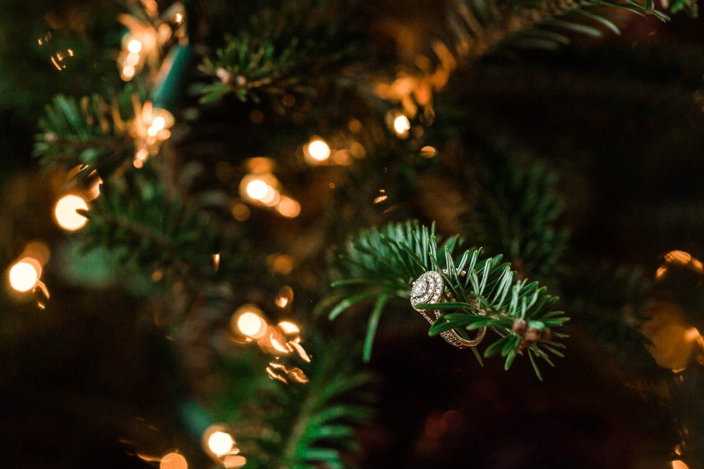 engagement ring detail shot on the christmas tree - Jessica + Brandon - Snowy Winter Wedding at the Rand Bryan House in Garner, NC - Raleigh North Carolina Wedding Photographer