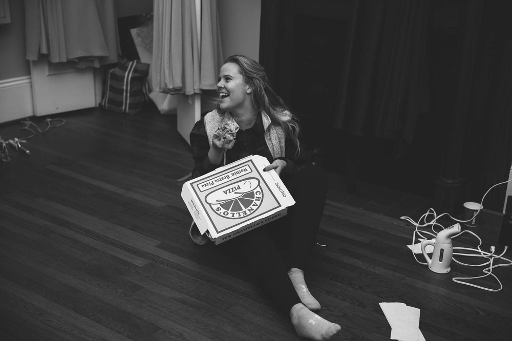 bridesmaids candid with pizza - Jessica + Brandon - Snowy Winter Wedding at the Rand Bryan House in Garner, NC - Raleigh North Carolina Wedding Photographer
