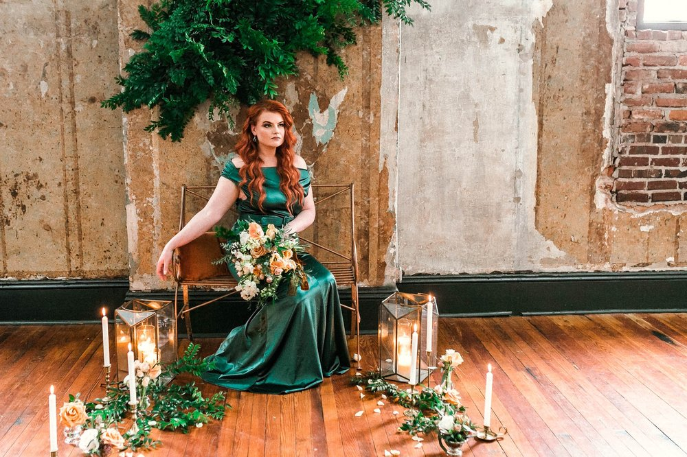 Ginger Bride in a unique Emerald Wedding Dress sitting surrounded by a gorgeous flower display for her Bridal Session - Oahu Hawaii Wedding Photographer - Johanna Dye Photography