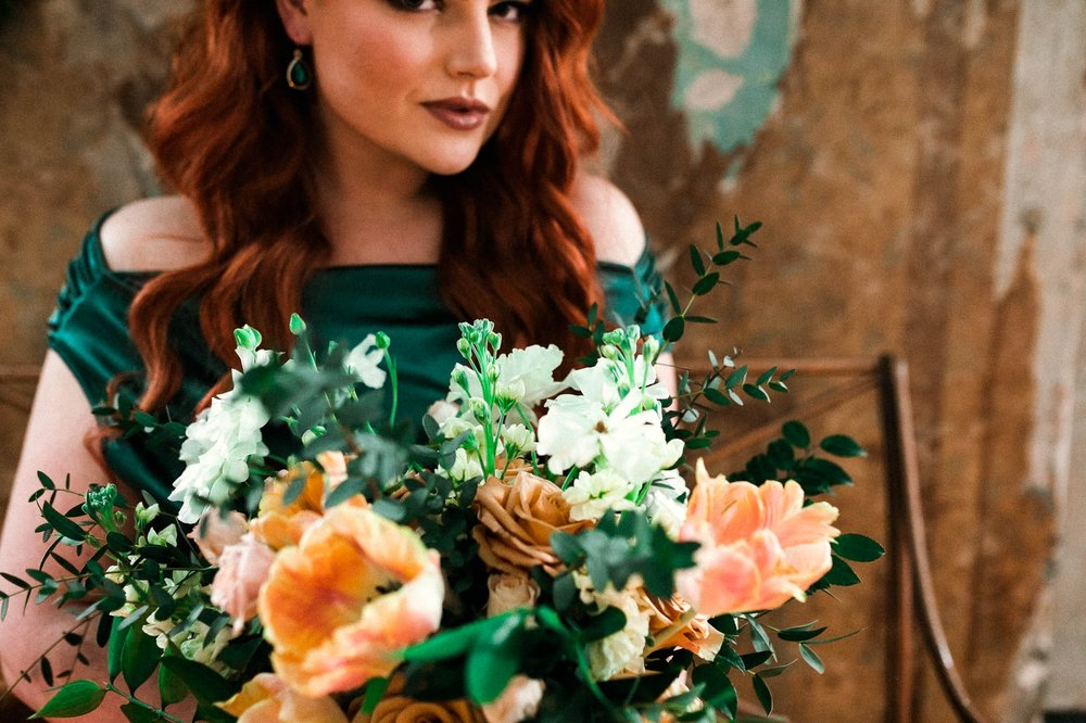 Detail shot of the Ginger Bride holding her bouquet while wearing an unusual emerald wedding dress and looking beautiful - Emerald City Green Wedding Inspiration - Oahu Hawaii Wedding Photographer