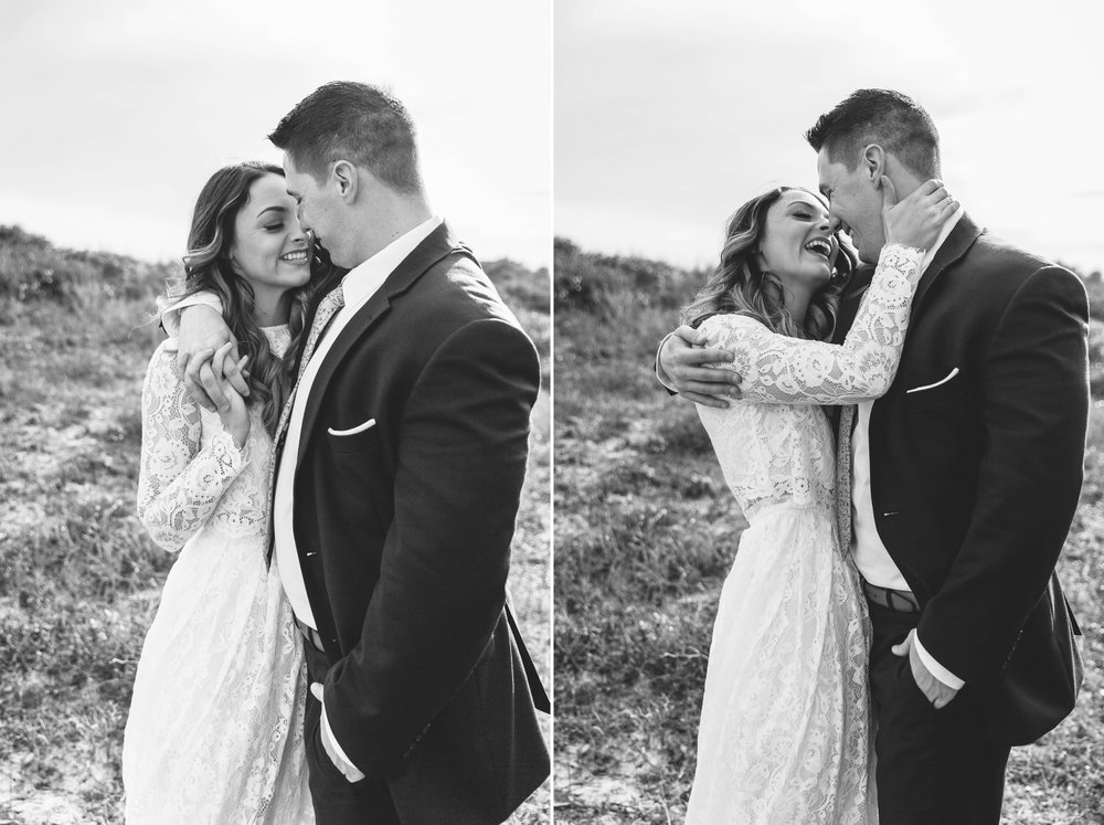 Black and white portrait of bride and groom laughing and hugging - Beach Elopement Photography - wedding dress by asos with purple and pink flowers and navy suit - oahu hawaii wedding photographer