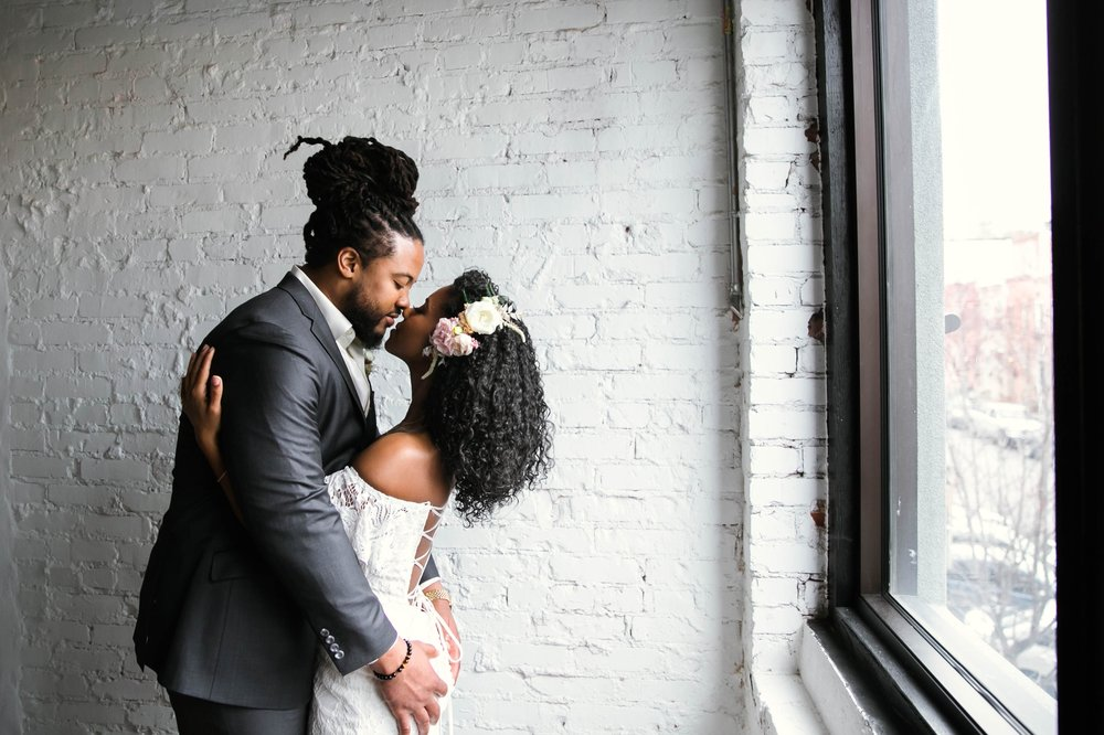 Indoor Wedding Portrait with natural light by a Window of an African American Black couple - boho tropical wedding inspiration by Honolulu, Oahu, Hawaii  Photographer