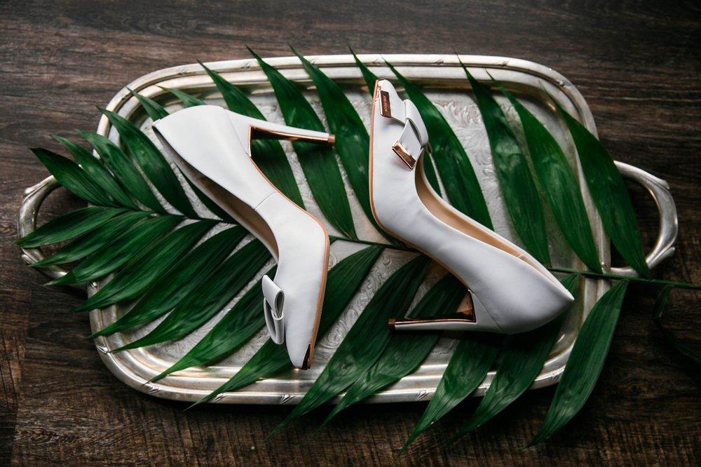 Detail shot lay flat of light blue wedding shoes - Tropical Destination Wedding Inspiration - Oahu Hawaii Wedding Photographer