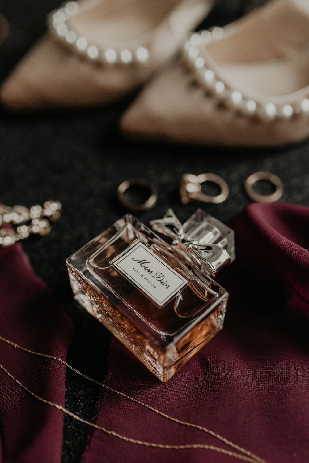 Detail shot of the brides perfume, the wedding and engagement ring, and the shoes - Matt Smarsh and Johanna Dye - Raleigh North Carolina Urban Edgy Downtown Wedding