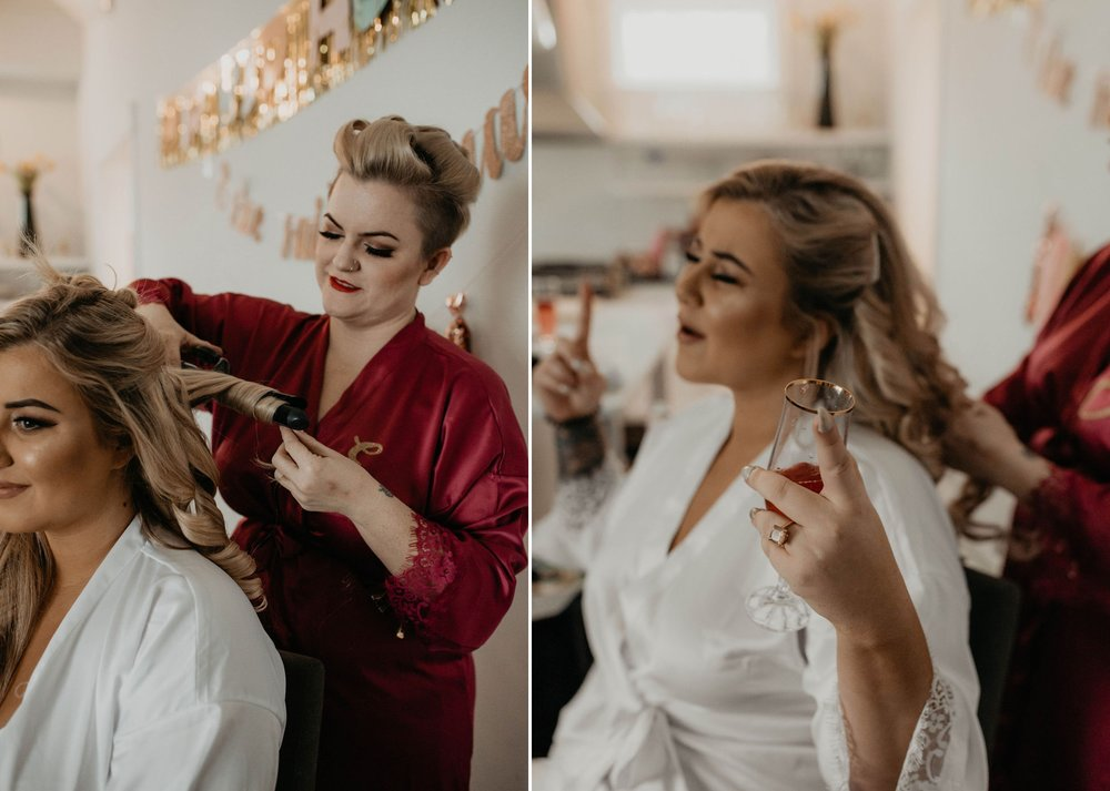 Bride getting ready in a white robe and getting her hair done by one of her bridesmaids while dancing - Matt Smarsh and Johanna Dye - Raleigh North Carolina Urban Edgy Downtown Wedding