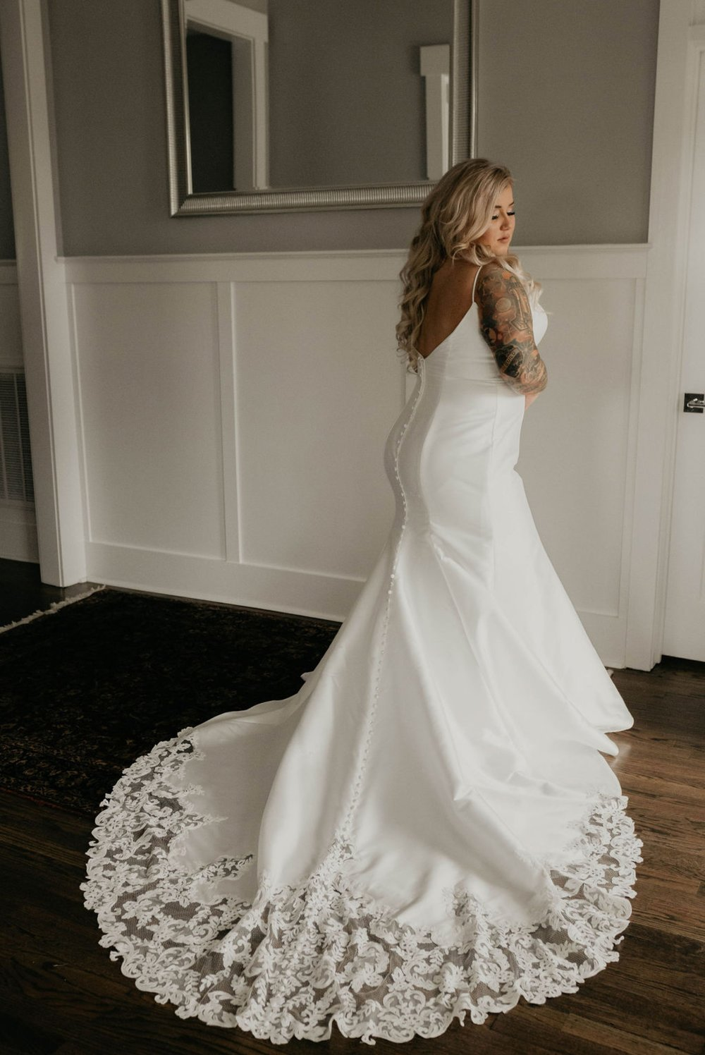 Bride in an allure bridals mermaid gown getting ready before the wedding - Matt Smarsh and Johanna Dye - suites by the black tux - Raleigh North Carolina Urban Edgy Downtown Wedding - suits by the black tux