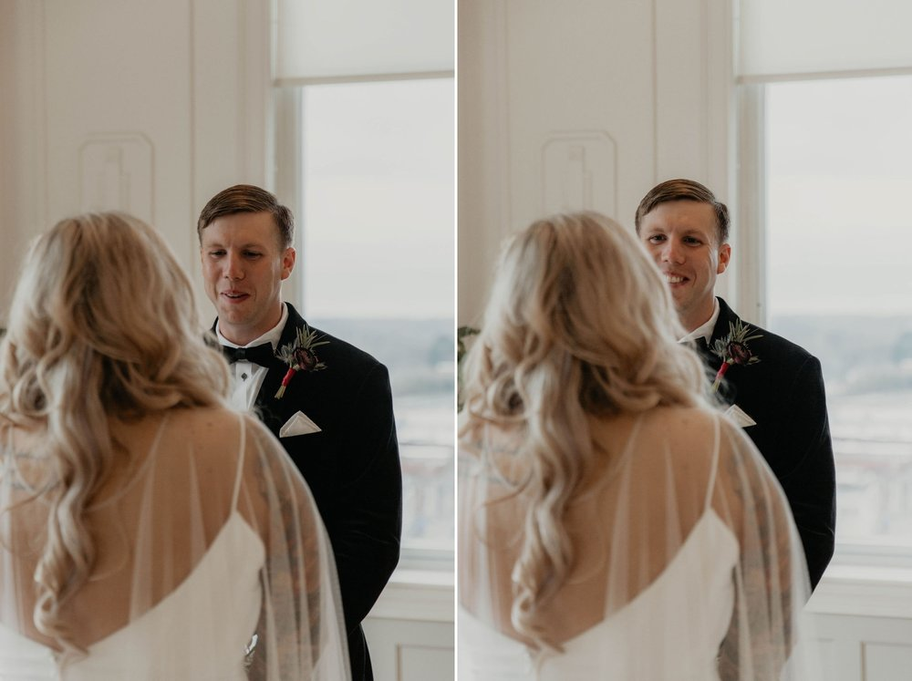 First look between bride and groom at the cannon room - Reaction of the Groom when he sees his bride for the first time -  Bride in an Allure Bridals Mermaid Gown - Matt Smarsh and Johanna Dye - suites by the black tux - Raleigh North Carolina Urban Edgy Downtown Wedding - suits by the black tux