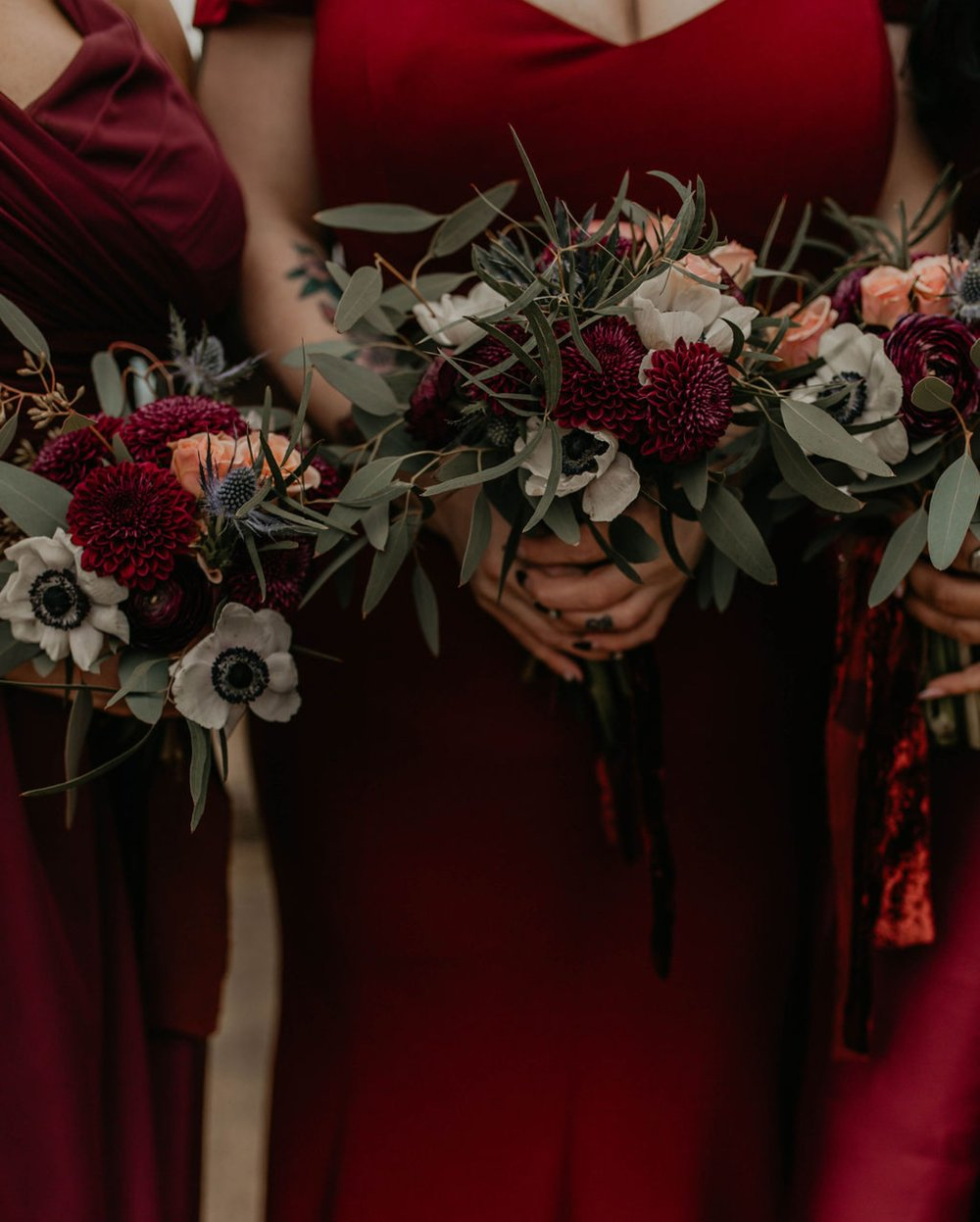 Bridesmaids Bouquet detail - Burgundy Bridesmaids dresses by davids bridal Matt Smarsh and Johanna Dye - suites by the black tux - Raleigh North Carolina Urban Edgy Downtown Wedding - suits by the black tux