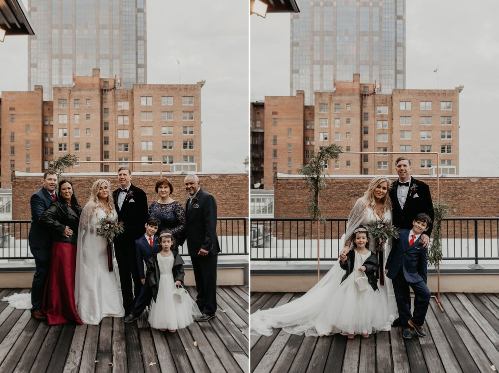 Family Portraits  on a rooftop terrace with the skyline in the background - Matt Smarsh and Johanna Dye - Raleigh North Carolina Urban Downtown Wedding at the Glass Box at 230