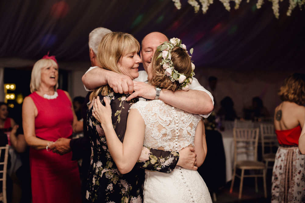I love this squishy moment on the dance floor where Megan shares a moment with her parents. These guys are family goals!