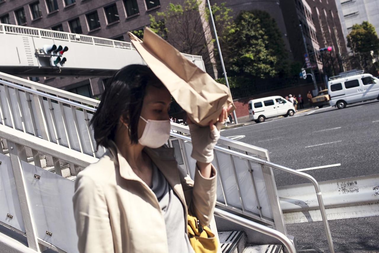 Tokyo. Sun and gloves and shadow and a paperbag.
