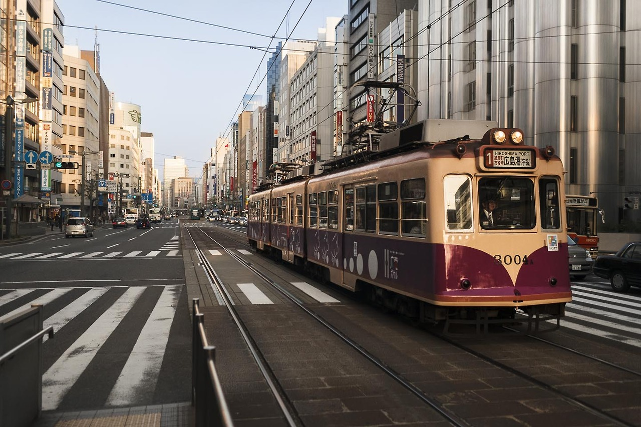 Beautiful old streetcar in the streets of Hiroshima riding into sundown. Japan reveals to be not nearly as hypermodern as westerns seem to think. Old and new things go hand in hand. So you can pay for your ride with touching a pad with your paspy card. Stil country with a love for extremes and with my love.