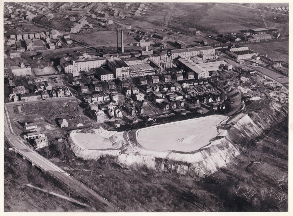"Keasbey and Mattison factory, showing Ambler's ""White Mountains,"" 1937.   Dallin Aerial Survey Company. Hagley Museum and Library."