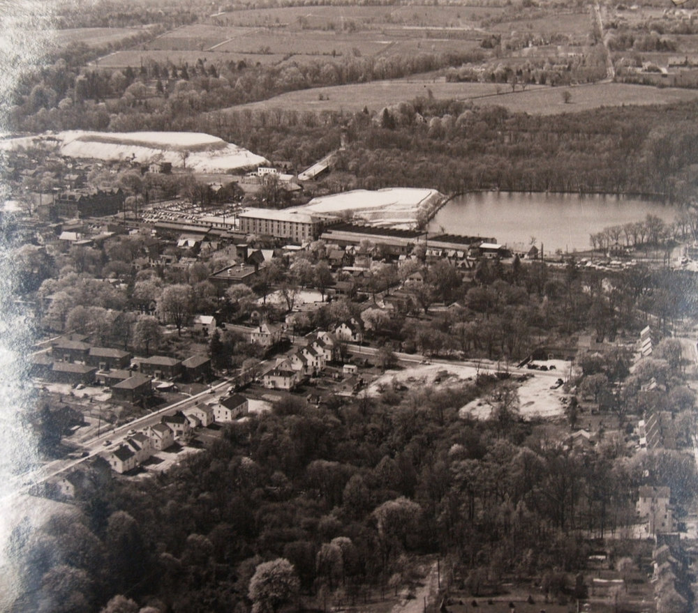 Aerial view of Ambler. BoRit (right) and Ambler asbestos pile site (left) visible in the middle ground, 1953.  Newton Howard Photo Collection, Historical Society of Montgomery County.