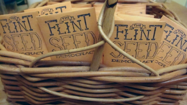 Hand stamped packages of seeds await distribution in Flint, Michigan. (Photo credit Russ Bedford)