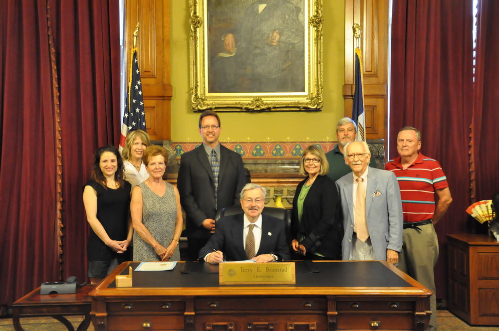 Governor Branstad is pictured with SSE co-founder Diane Ott Whealy and other members of the SSE family at the June 10 signing ceremony at the state capitol. (Photo courtesy of the Office of the Governor)
