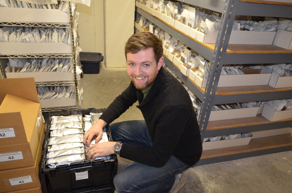 Zach Row-Heyveld, Seed Savers Exchange Inventory Technician, prepares seed for shipment.
