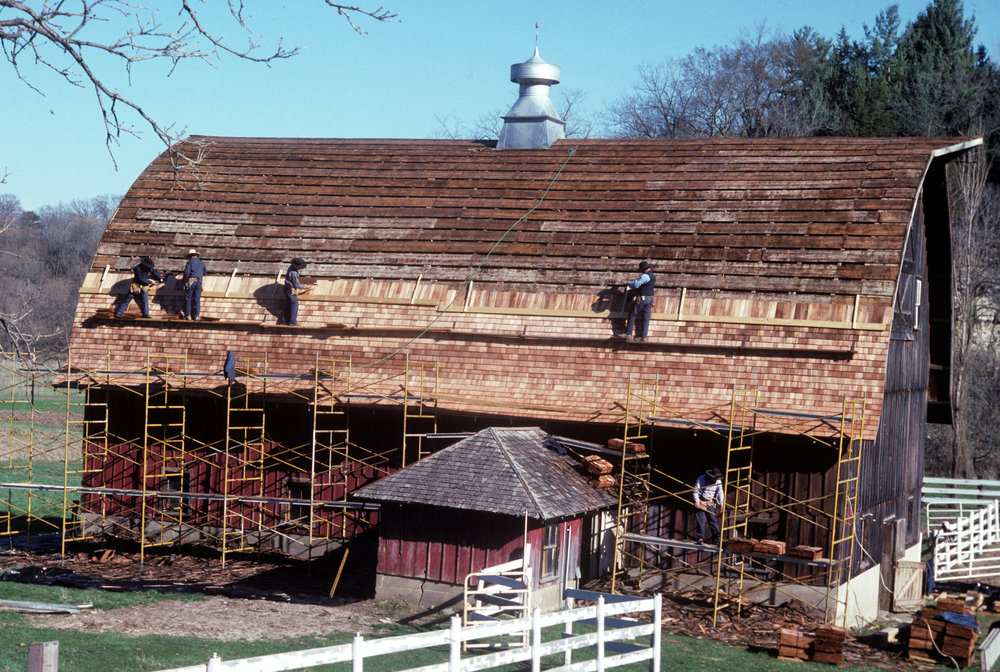 """""""The next day, my view included four or five Amish carpenters on scaffolding, fearless and sometimes shoeless, shingling the steep barn roof,"""" Diane Ott Whealy, in her 2011 memoir."""