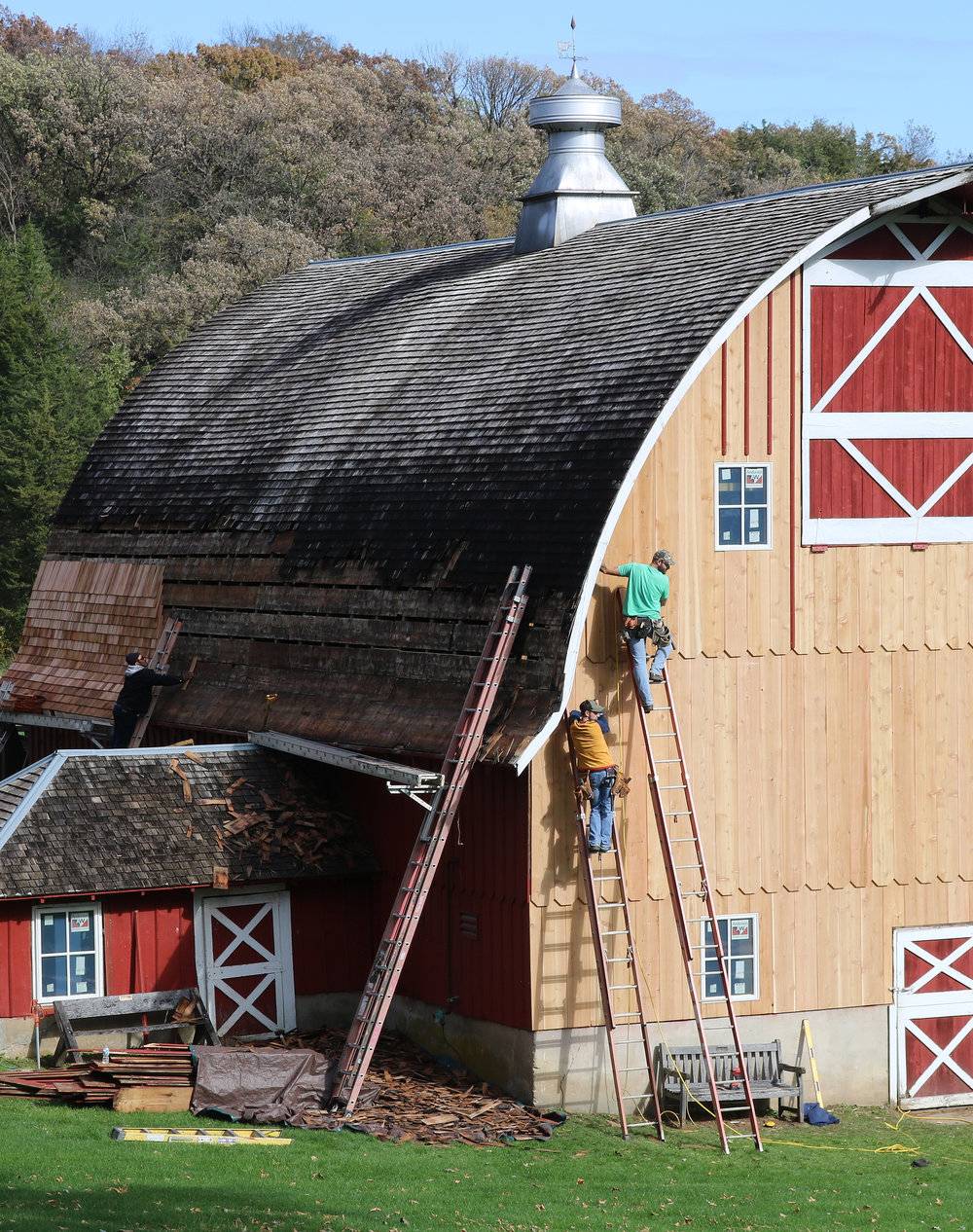 Crews spent plenty of time working atop ladders during the renovation of the historic barn at Heritage Farm this past October.