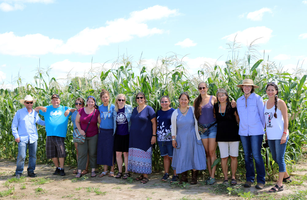 Rowen White (fifth from right) gathers with Seed Savers Exchange staff and fellow ISKN members in the cornfields at Heritage Farm this summer.