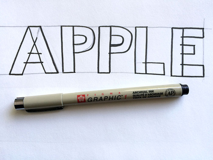Outline the letter with a pen