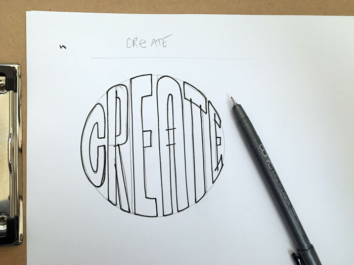 Carefully ink the outline of your hand lettering using a black inking pen.