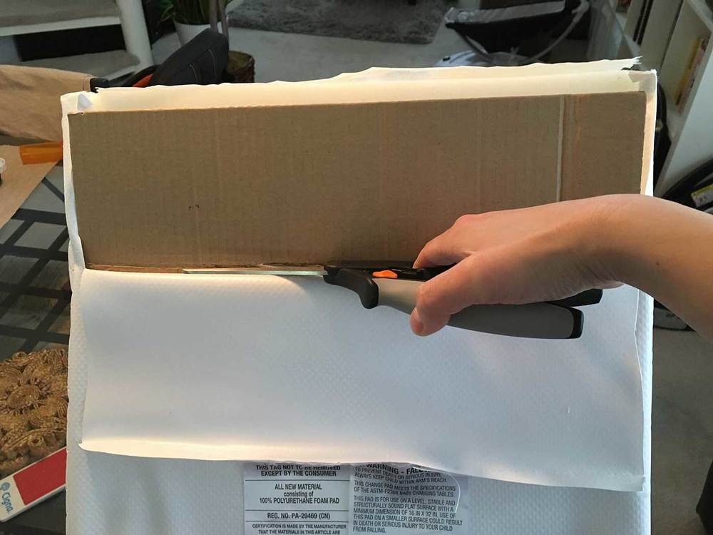Cut the cardboard and foam to size  - Easy baby DIY project for a changing table pad for the IKEA SNIGLAR