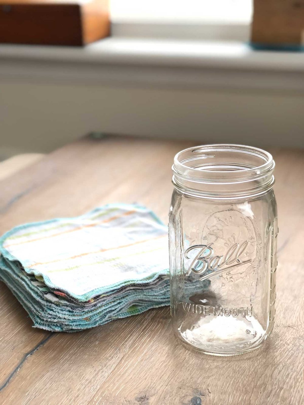 Cloth wipes ready to be folded and placed in a jar