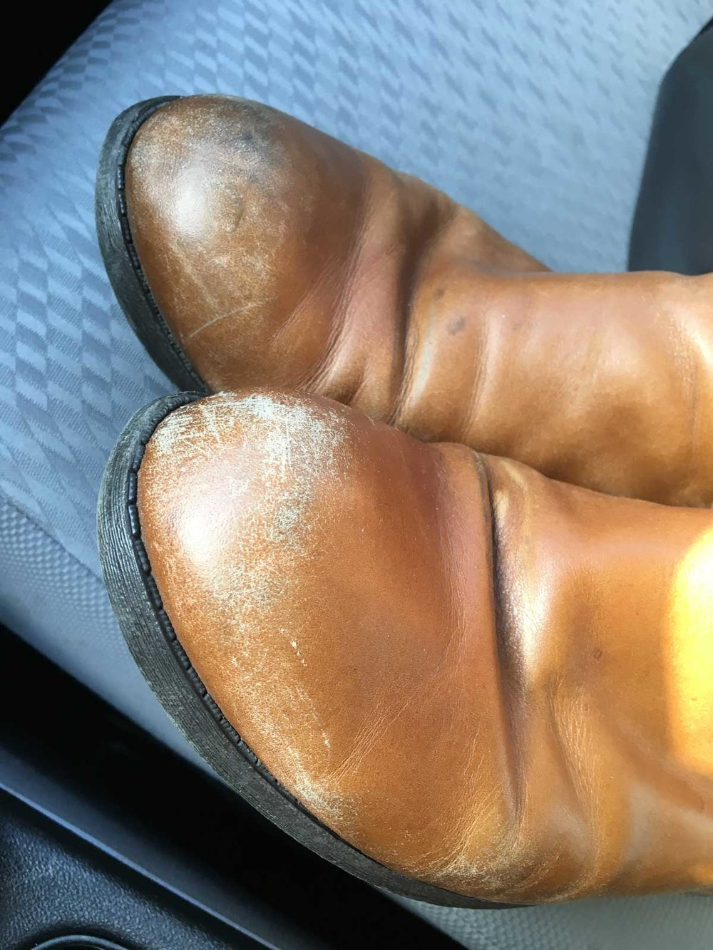 Boots before repair - the toes are in bad shape