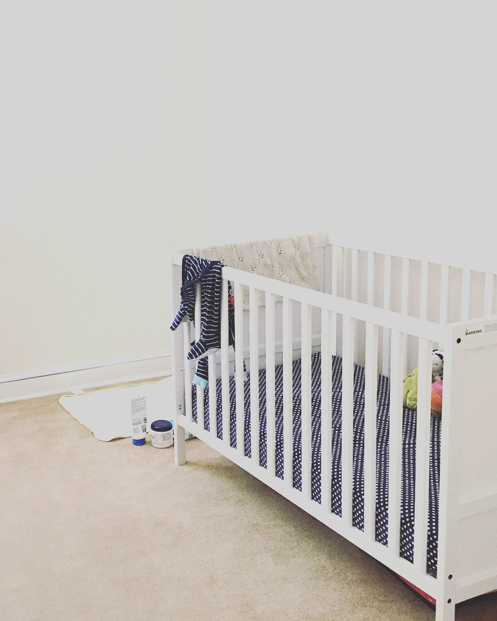 Minimalist baby nursery: crib and changing station