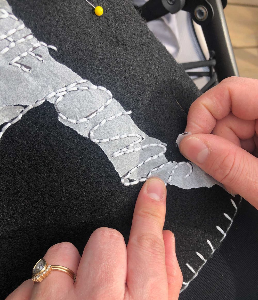Gently pull away the tracing paper from your embroidery stitched lettering.