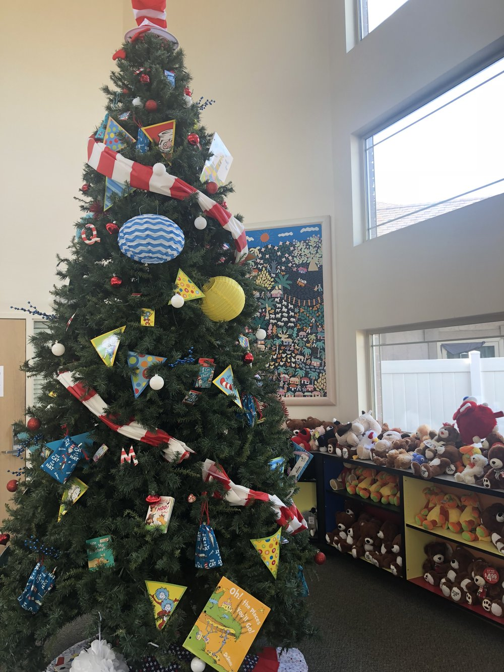 A Christmas Tree Adorned With Lights And Ornaments In A