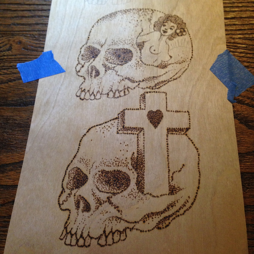 """""""Peeking Pinup & Skull and Cross""""  6"""" x 12""""  Burned birch wood panel  NFS - In the collection of Greg Christian"""