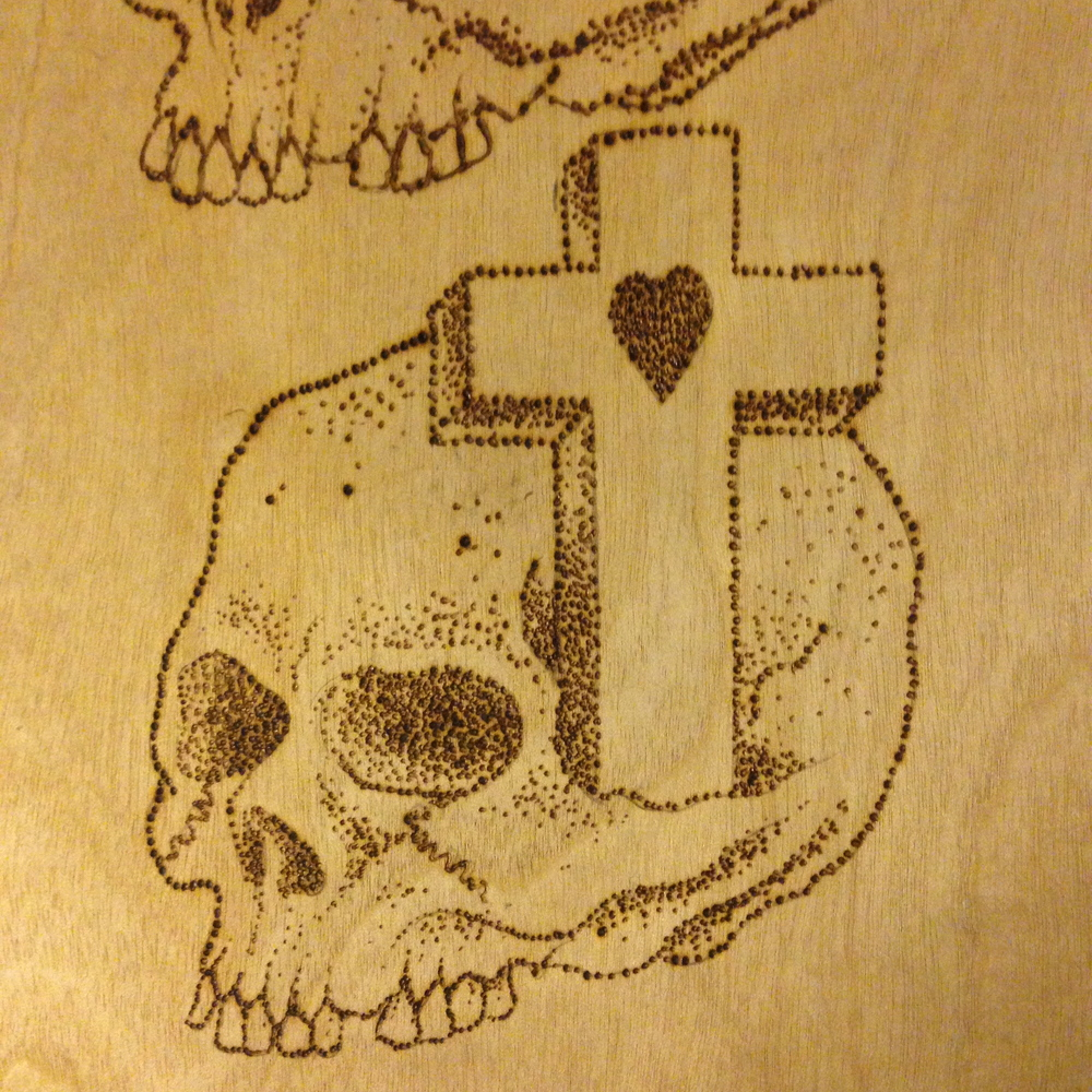 """Skull & Cross""  Burned wood panel"