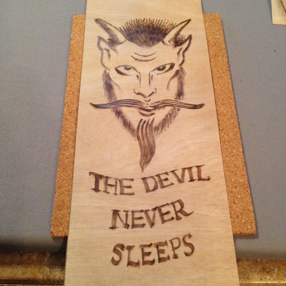 """The Devil Never Sleeps""  6"" x 14""  Burned wood panel  NFS - In the collection of Jeb Maykut"