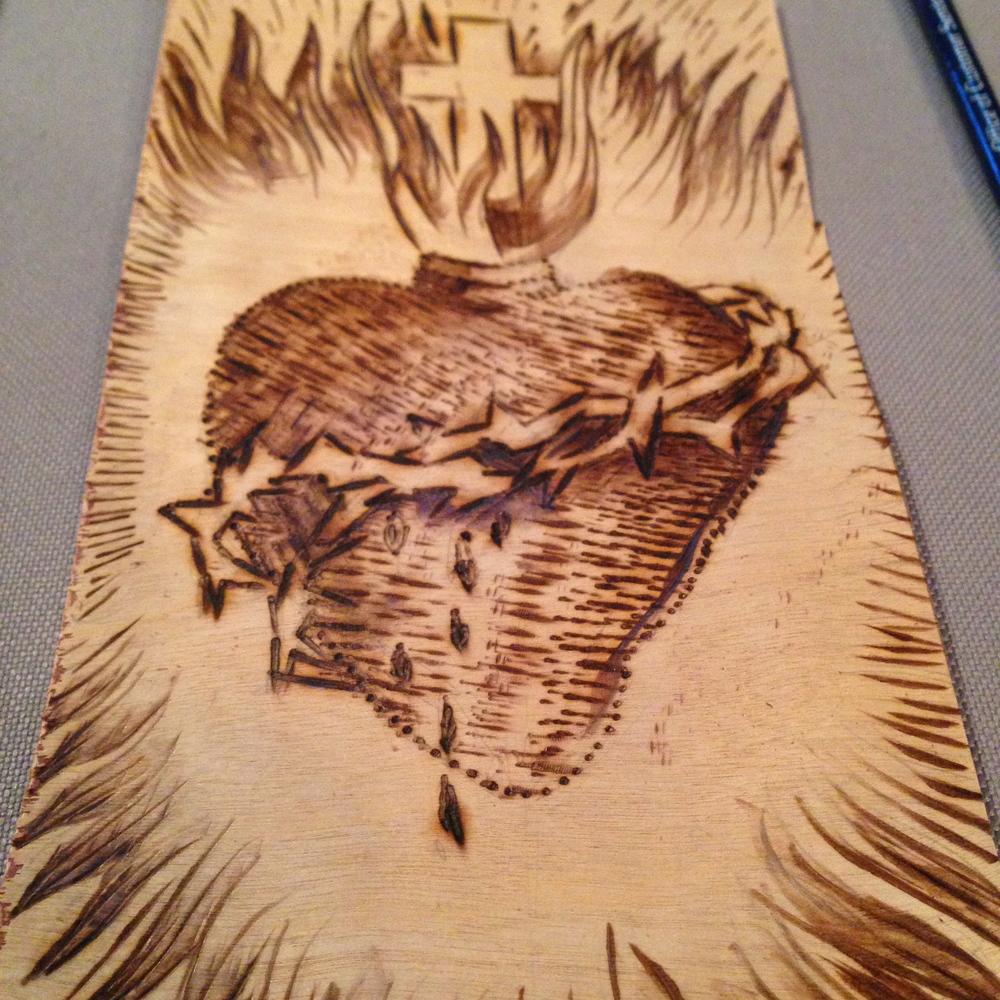 """Sacred Heart""  6"" x 12""  Burned birch wood panel  NFS - Mom & Dad"