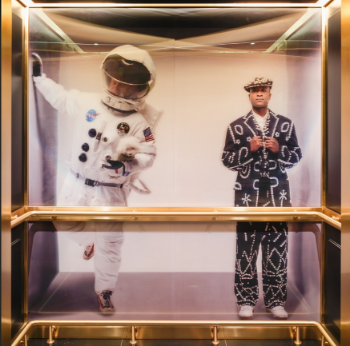 Tom Dixon poses as an astronaut in a lift