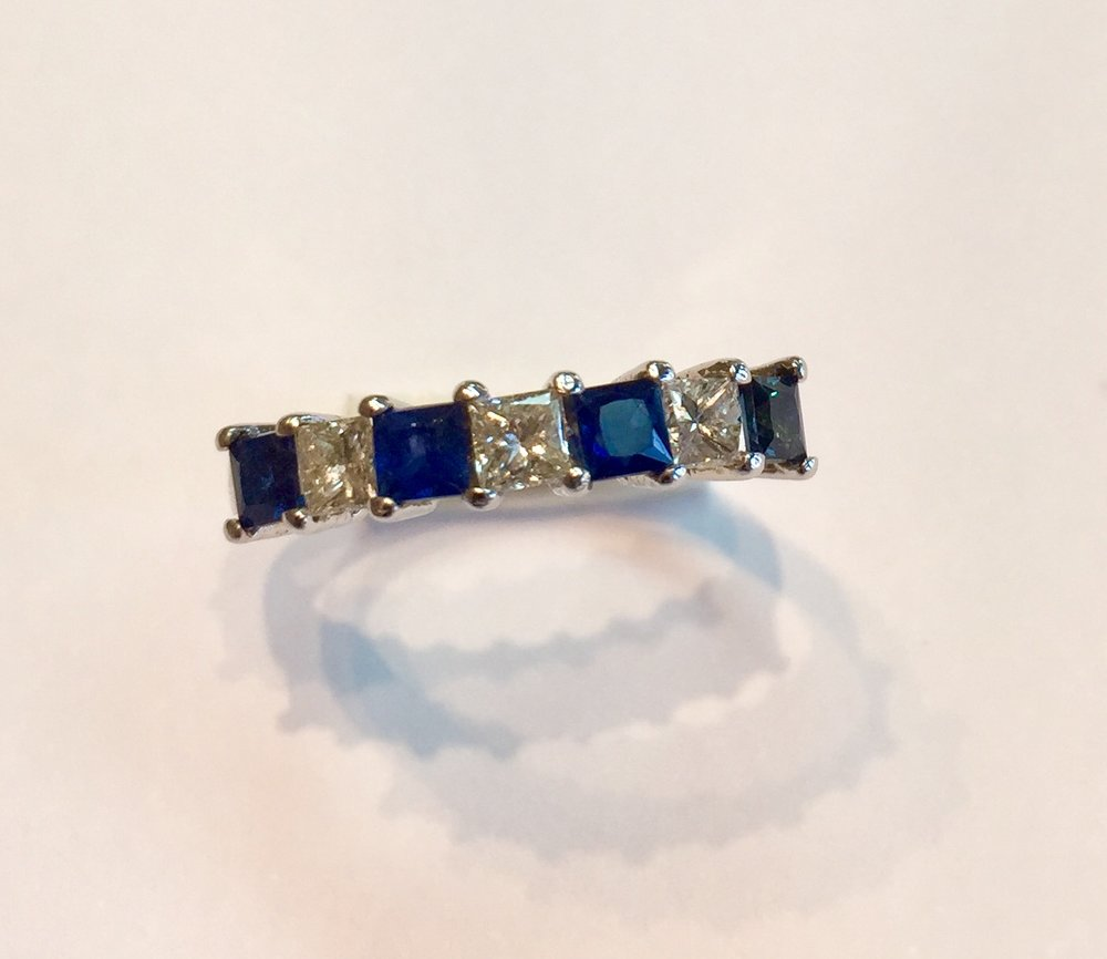 AB64 USD645  14K White Gold Blue Sapphire and Diamond Ring  Classic and timeless ring with 3 quality princess cut diamonds and 4 quality princess cut sapphires. .36 carat of diamonds and .6 carat of diamonds.