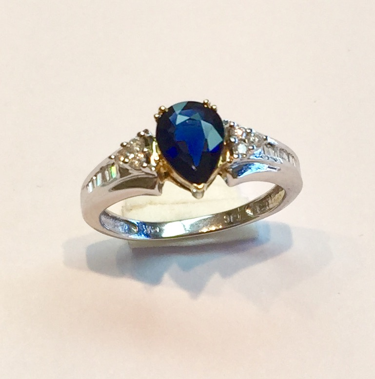 Item no AB57 USD445  14k White and Yellow Gold Sapphire and Diamond Ring  Madagascar blue pear shaped sapphire weighing .84 carat set in 14k yellow gold accented with round and white diamonds weighting .18 carat and are all set in 14k white gold.  Delightful