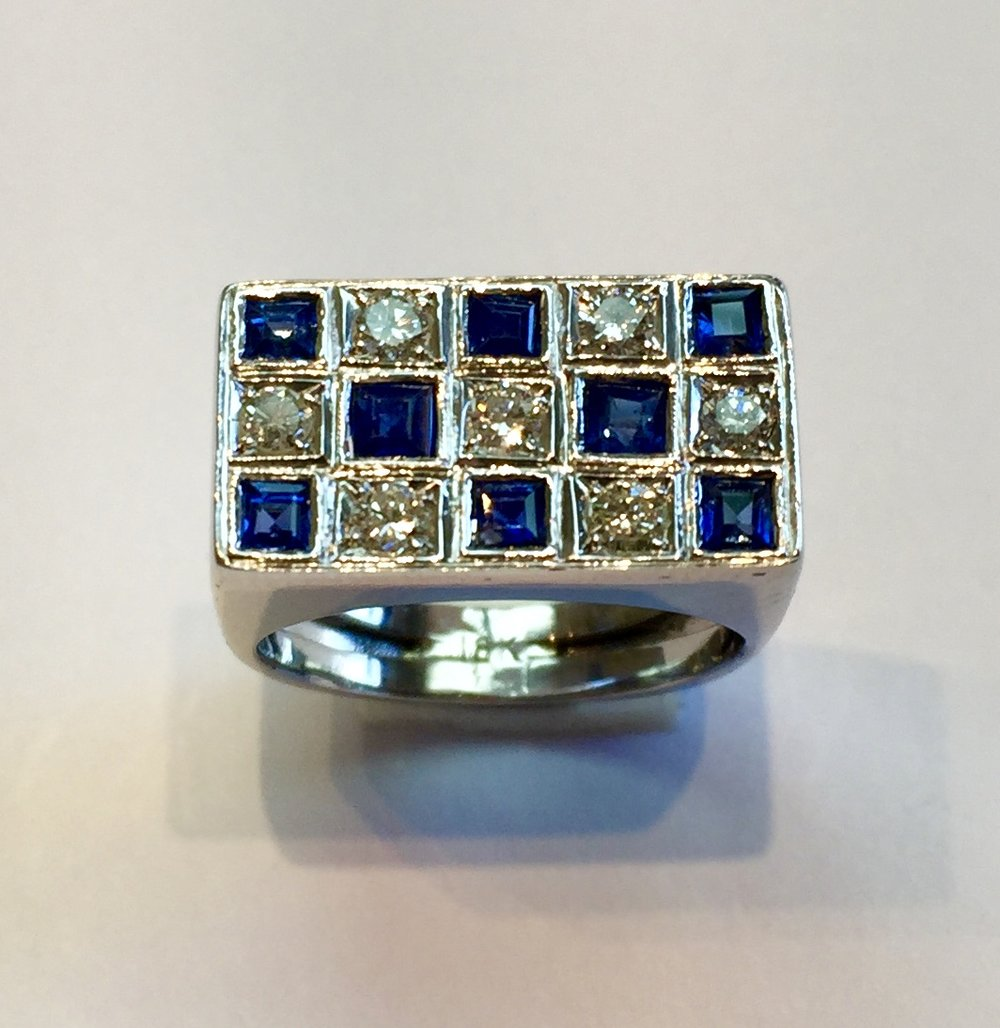 Item No AB88  18k White Gold Blue Sapphire and Diamond Ring  Substantial ring with high quality gem stones. A half carat of clear sparkling white diamonds and just under a carat (.96) of rich blue sapphires.  It's a knockout.  6.8 grams